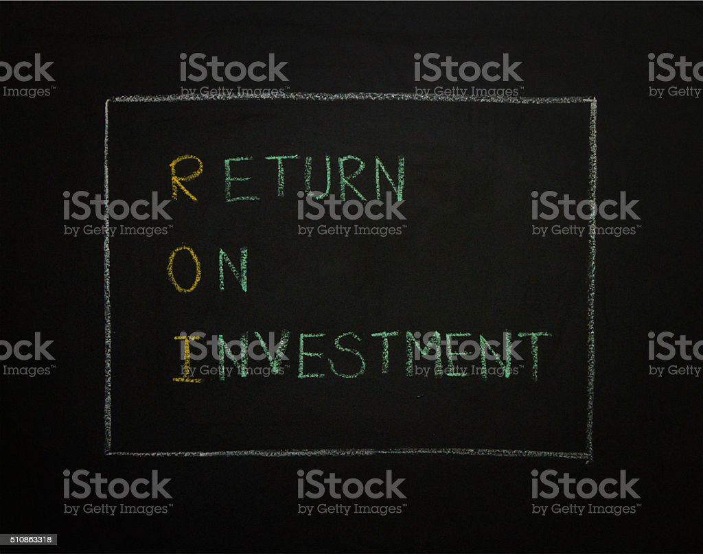 RETURN ON INVESTMENT on black background. stock photo