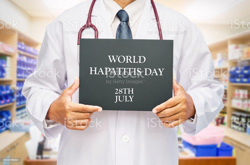 STOP HEPATITIS on chalkboard in doctor hand. stock photo