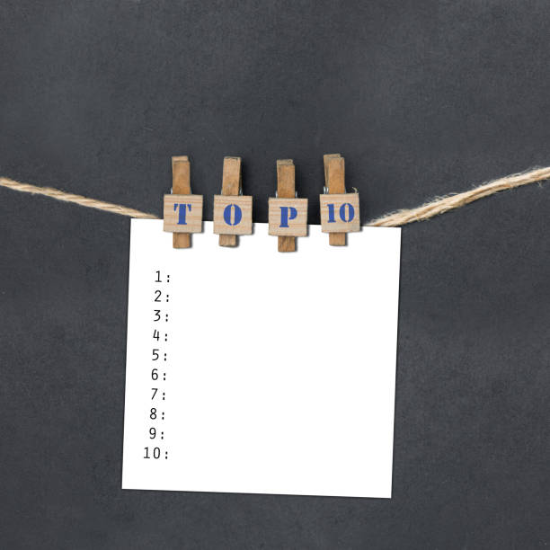 TOP 10 on clothespins holding a piece of paper stock photo