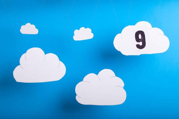 On cloud nine concept phrase cutouts stock photo