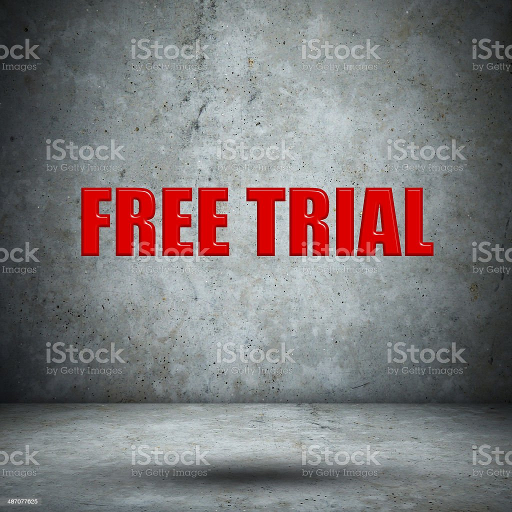 FREE TRIAL on concrete wall stock photo