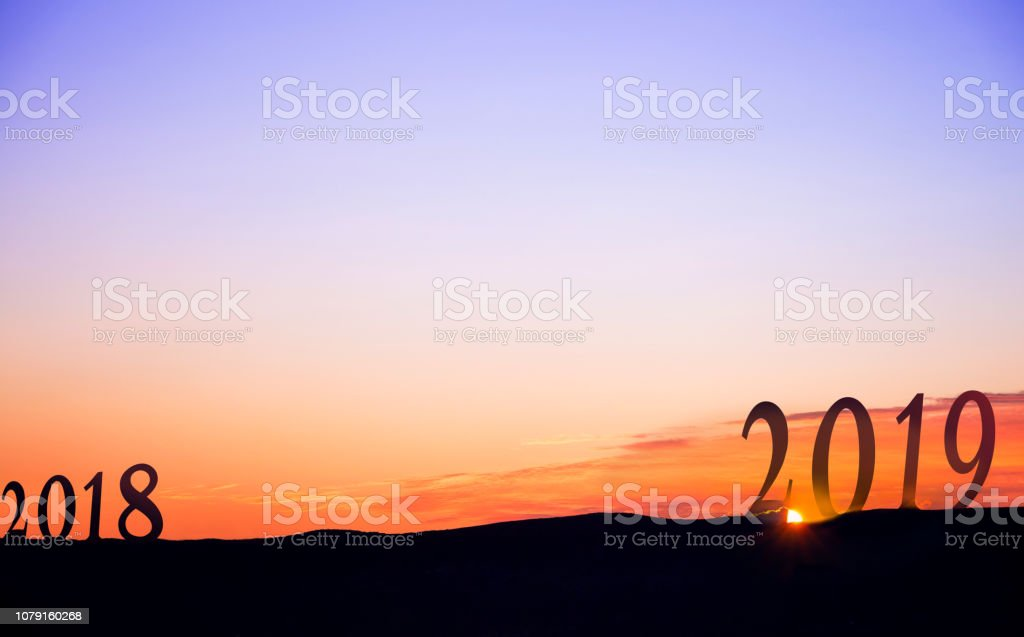 2019 On dark mountains, with vivid and beautiful sunrise as background. stock photo