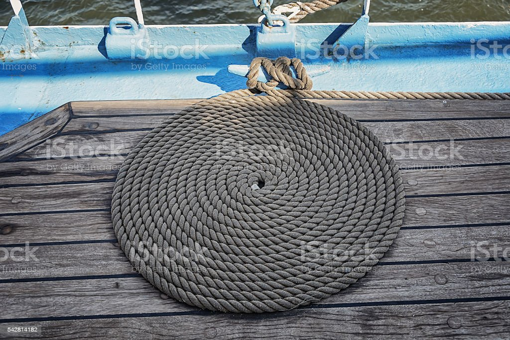 On deck a neatly coiled rope ship stock photo