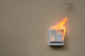 On fire electric switch  shock on the concrete wall caused by a short circuit