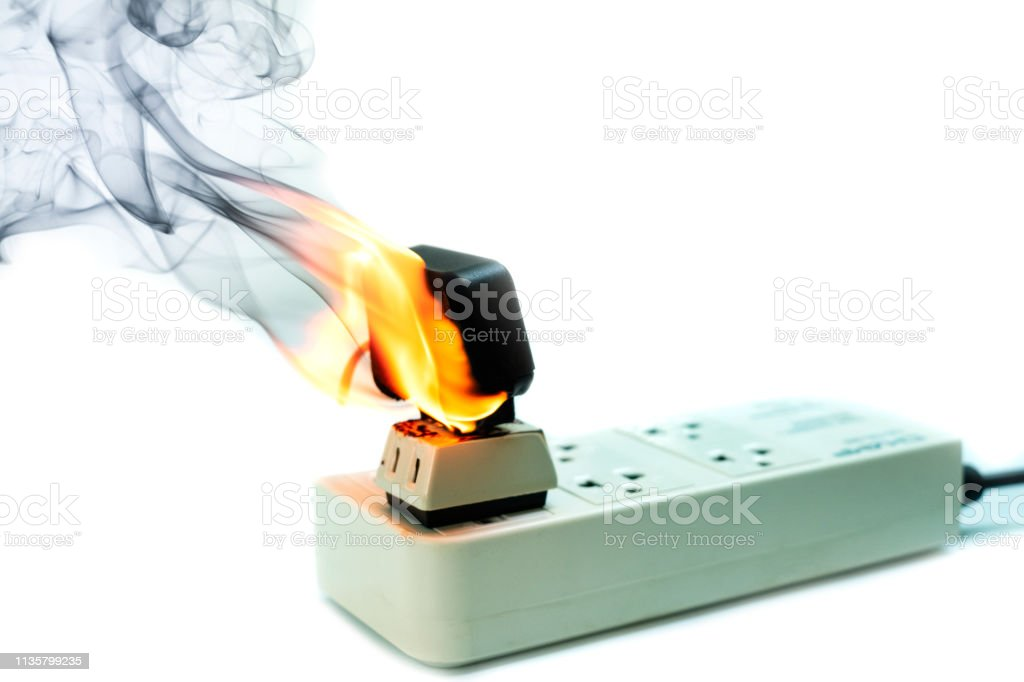 On Fire Electric Wire Plug Receptacle And Adapter On White ... Wiring A Plug Outlet on