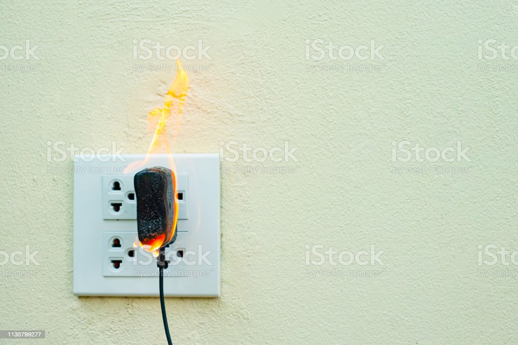 On Fire Electric Wire Plug Receptacle Wall Parionelectric ... Wiring A Plug Outlet on