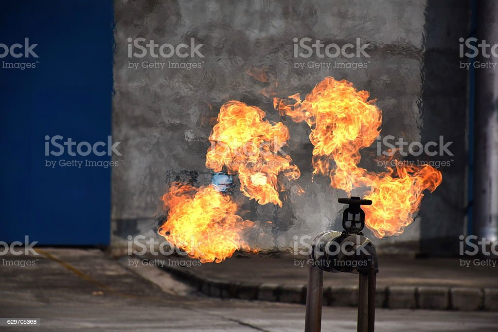 On fire with gas leak from pipe and valv. stock photo