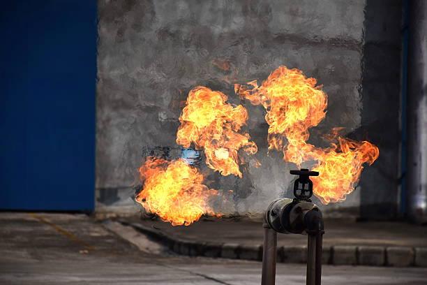 on fire with gas leak from pipe and valv. - druck strumpfhosen stock-fotos und bilder