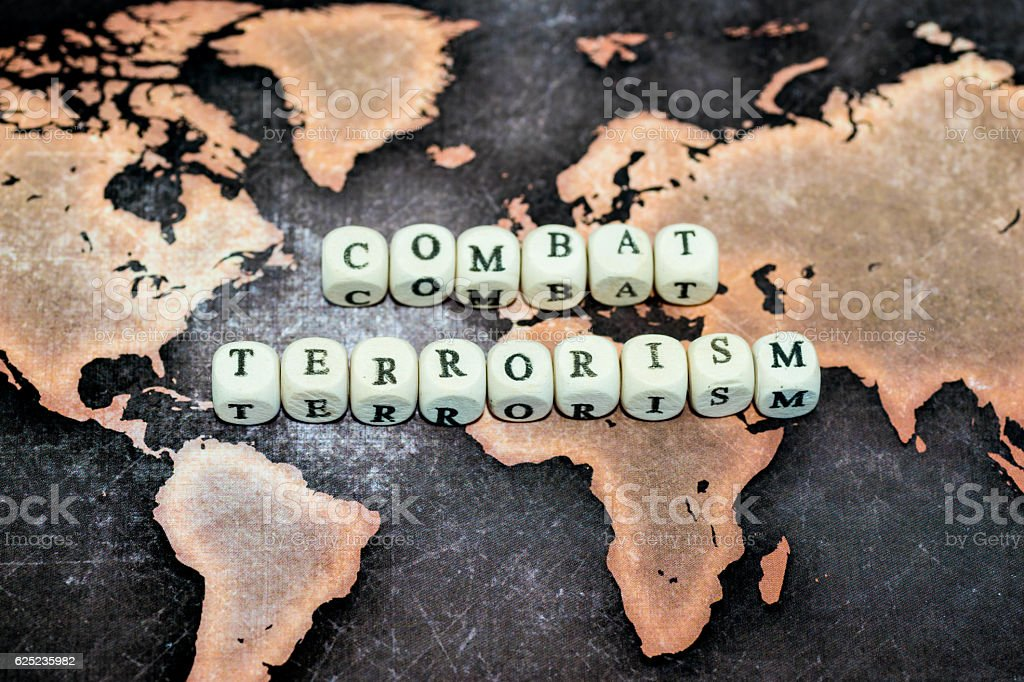 COMBAT TERRORISM on grunge world map COMBAT TERRORISM on grunge world map Aggression Stock Photo