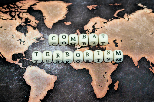 Combat Terrorism On Grunge World Map Stock Photo - Download Image Now