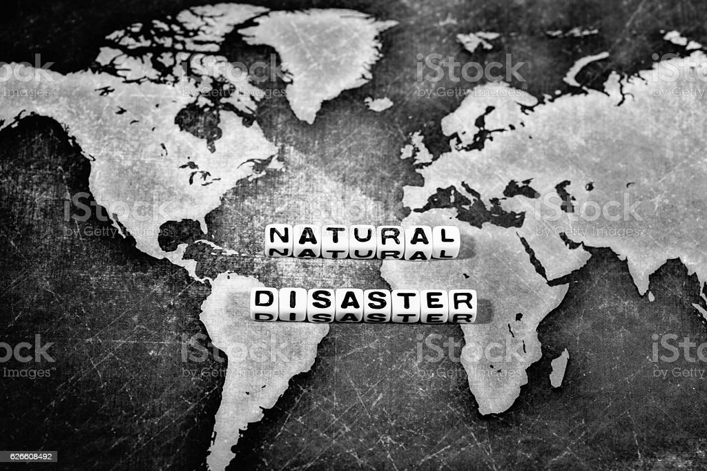 NATURAL DISASTER on grunge world map stock photo