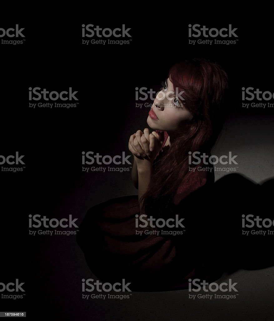 On his knees praying with faith royalty-free stock photo