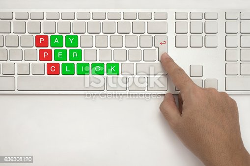 PPC , Hand with PAY PER CLICK concept on Keyboard