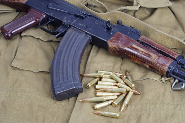 AK47 on khaki uniform background stock photo