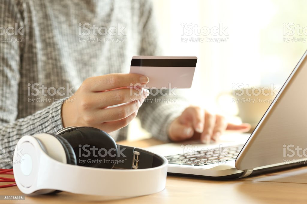 On line buyer buying music with a laptop stock photo