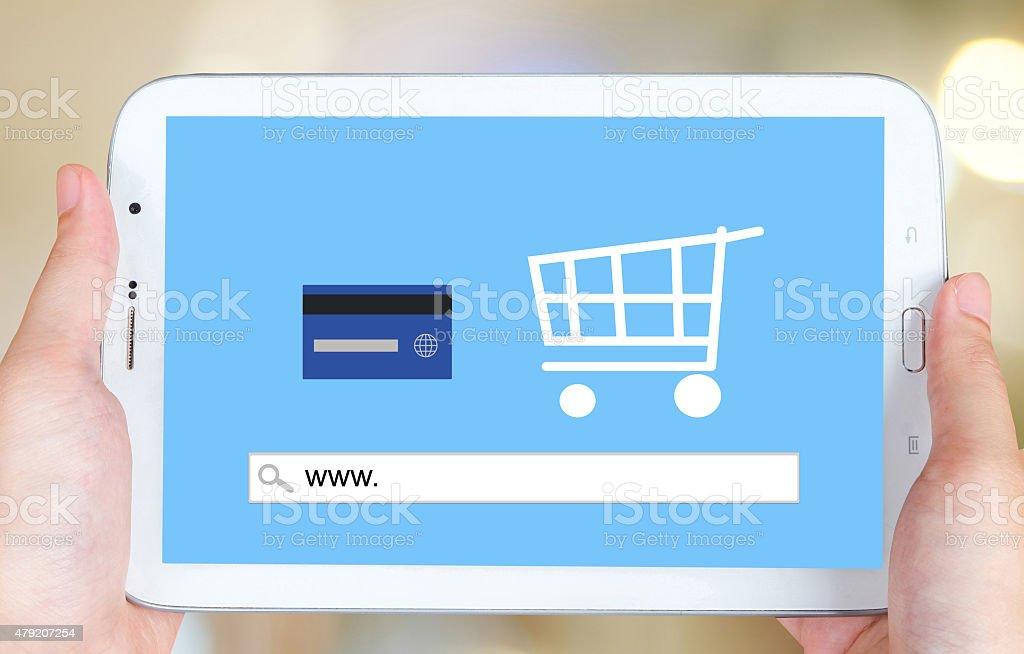 On line shopping on tablet screen, E-commerce stock photo