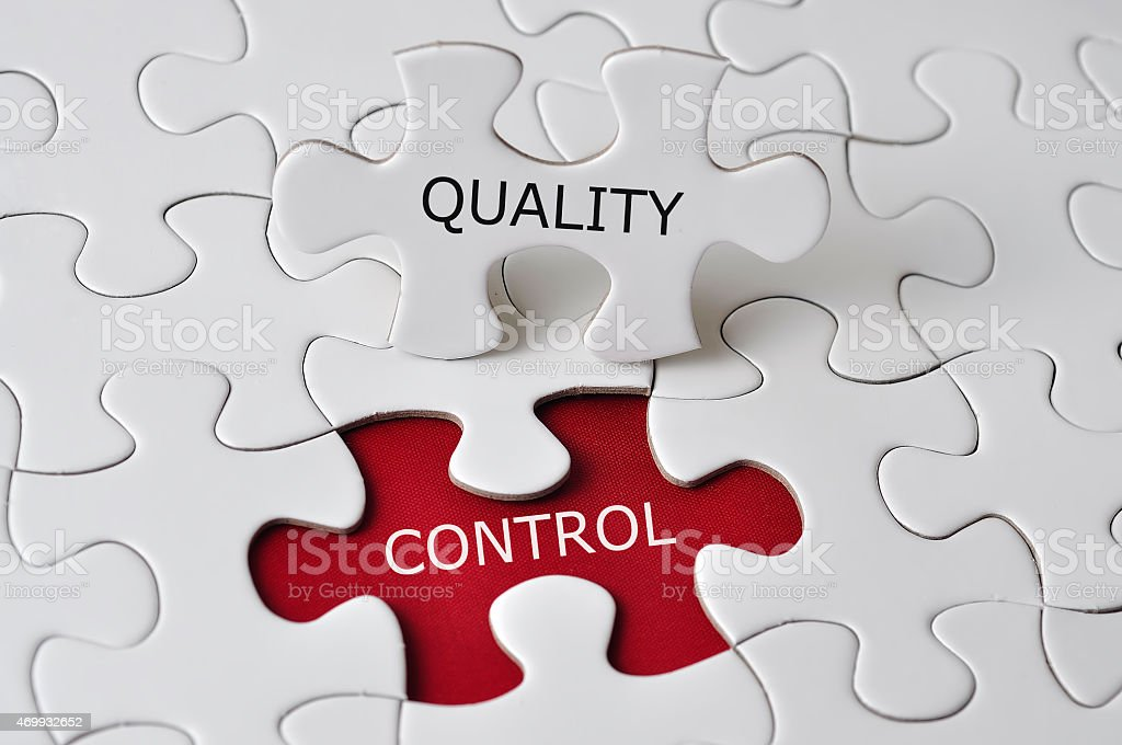 'QUALITY CONTROL' On Missing Piece Puzzle stock photo