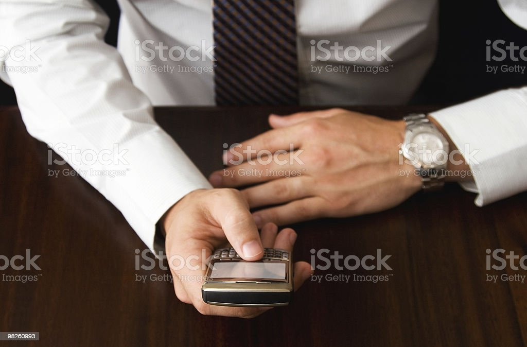 On Mobile at Desk royalty-free stock photo