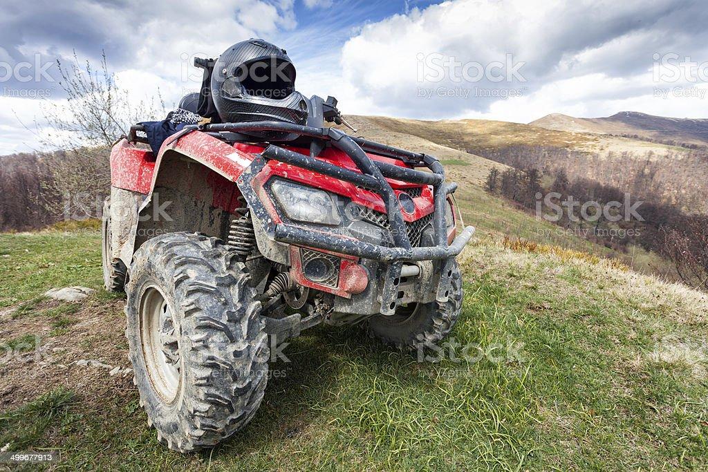 ATV on mountains landscape a sunny day stock photo