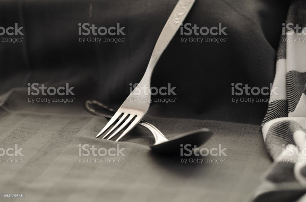 On napkin texture with fork spoon top view,dark style royalty-free stock photo