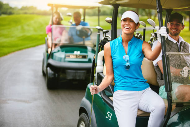 on our way to the next shot - female golfer stock photos and pictures