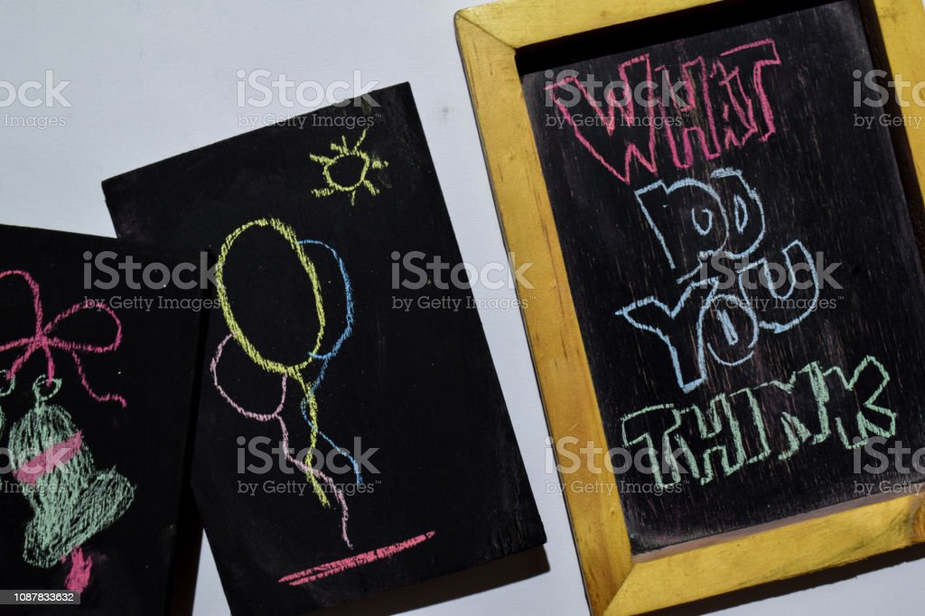 WHAT DO YOU THINK on phrase colorful handwritten on blackboard stock photo