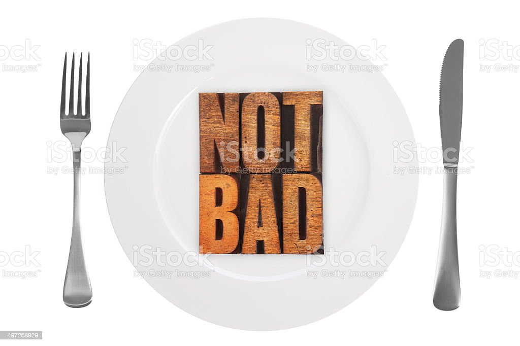 NOT BAD on Plate and Knife and Fork on White stock photo