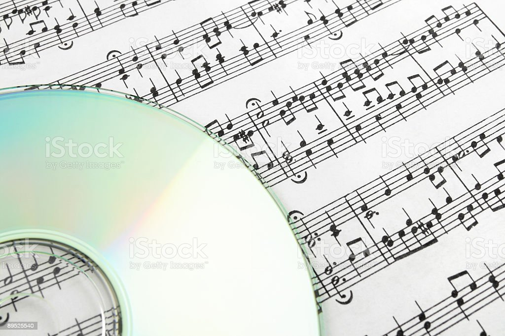 CD on sheet music royalty-free stock photo