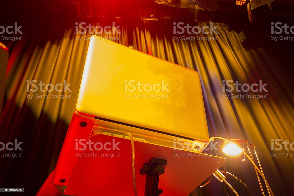 On stage laptop - modern DJ at work royalty-free stock photo