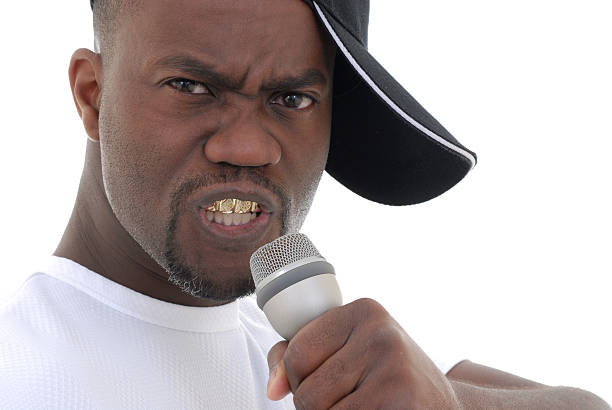 On stage Rapper. gold teeth bling stock pictures, royalty-free photos & images