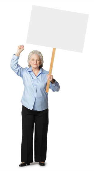 Striking or protesting senior woman with fist raised holding a blank sign.