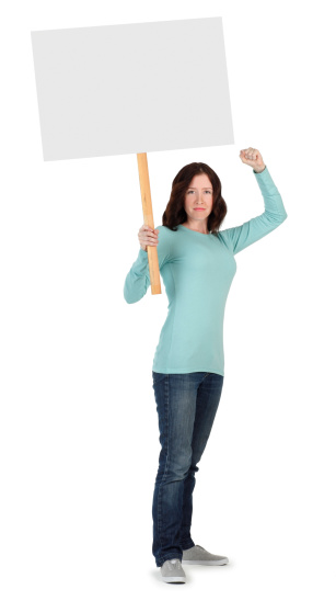Striking or protesting young woman with fist raised holding a blank sign.
