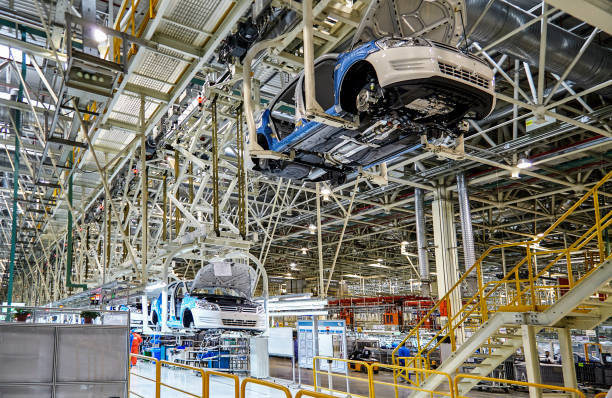 On the assembly line of the Shanghai Volkswagen manufacturing workshop, the automated robotic arm is installing the Chinese-made Volkswagen sedan on the assembly line. Shanghai, China, China - January 12, 2016: On the assembly line of the Shanghai Volkswagen manufacturing workshop, the automated robotic arm is installing the Chinese-made Volkswagen sedan on the assembly line. vehicle brand name stock pictures, royalty-free photos & images