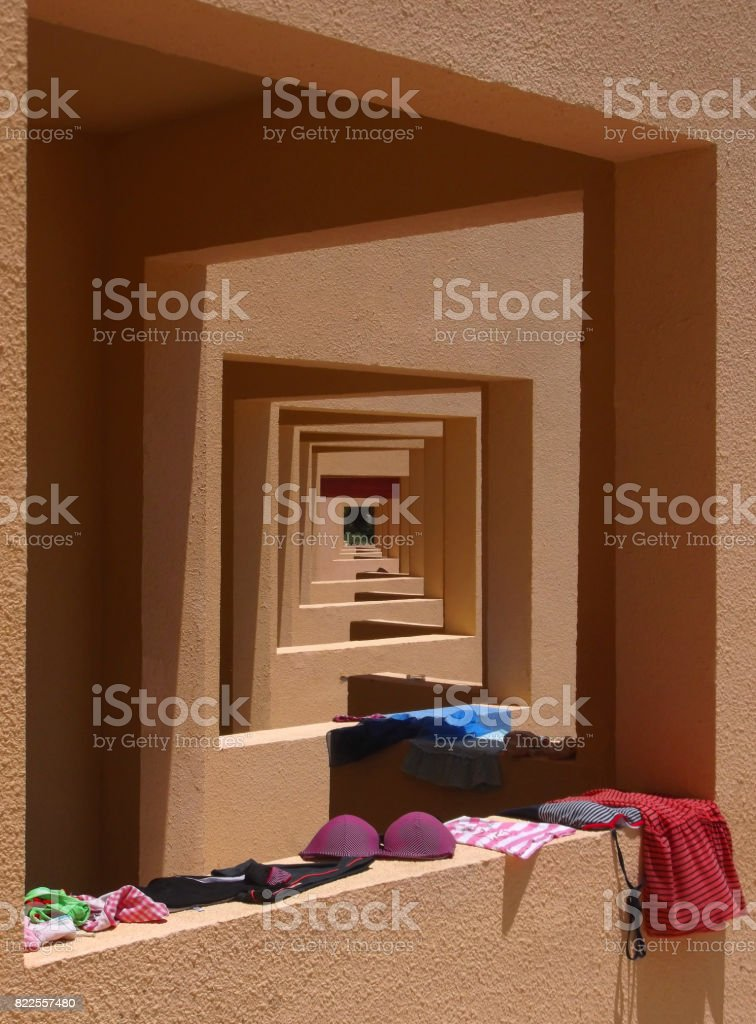On the balcony under the sun drying things. stock photo