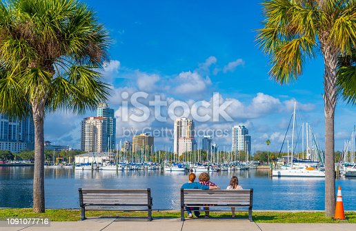 Young adults on a park bench over the bay at St. Petersburg.