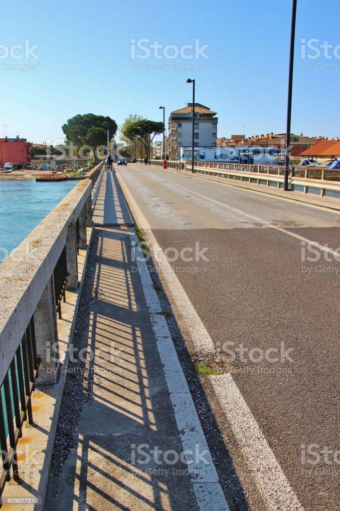 On the bridge of Grado, Italy. stock photo