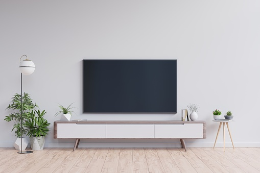 TV on the cabinet in modern living room on white wall background,3d rendering