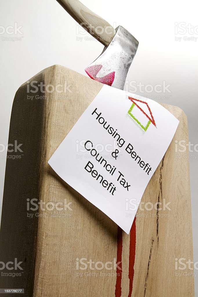 On the Chopping Block: Housing benefirt royalty-free stock photo