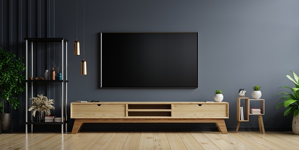 LED TV on the dark wall in living room with wooden cabinet,minimal design,3d rendering