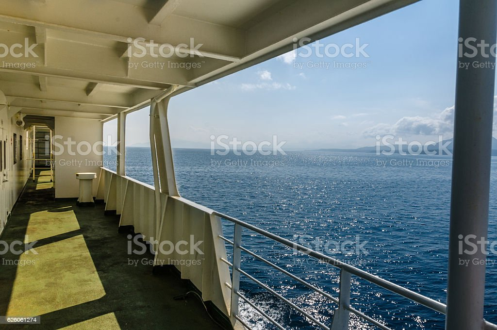 on the deck, watch the sea stock photo