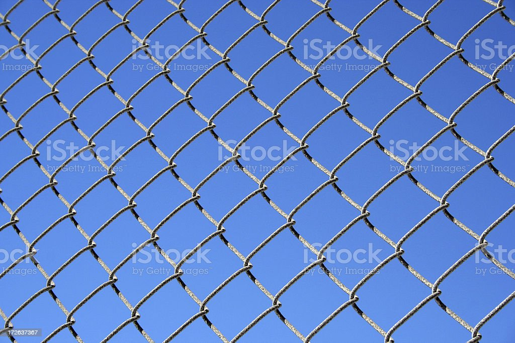 On the fence - Detail of metal barrier royalty-free stock photo