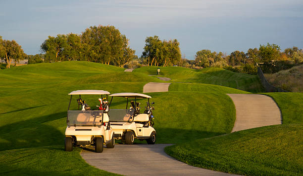 On the Green Golf Course Karts Waiting for Golfers stock photo