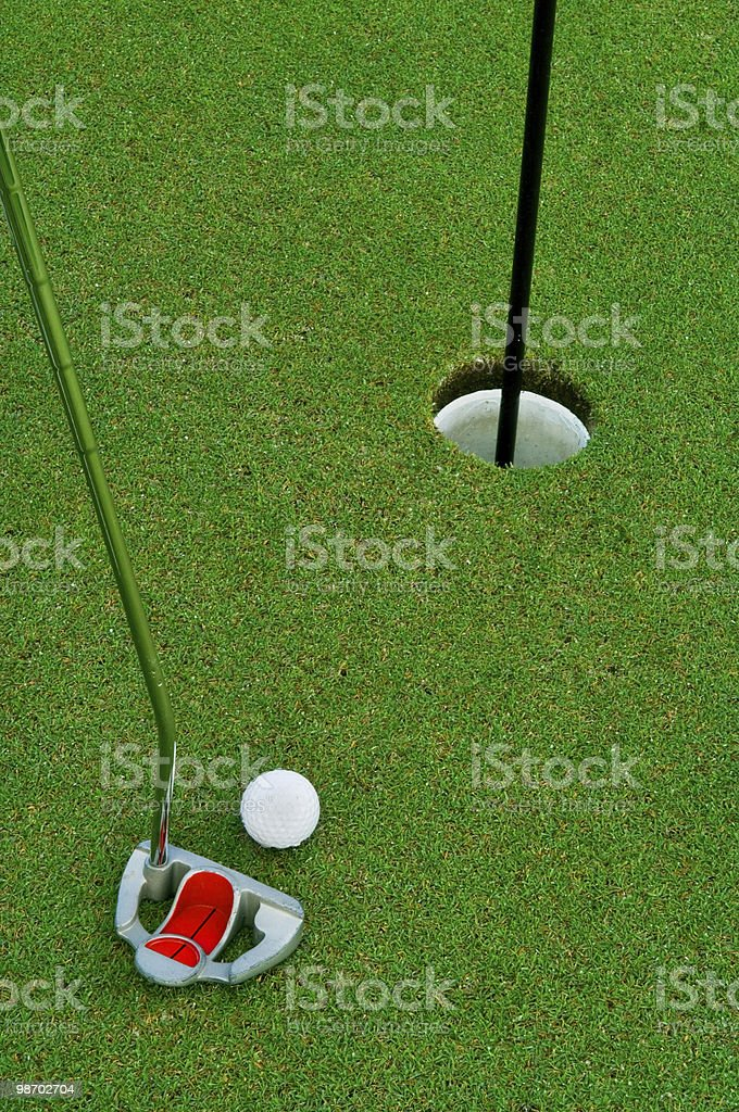 on the green with short putt royalty-free stock photo