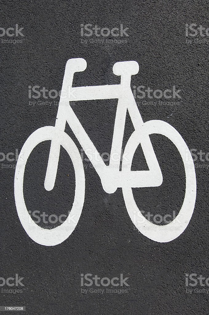 On the ground street sign of bicycle lane royalty-free stock photo