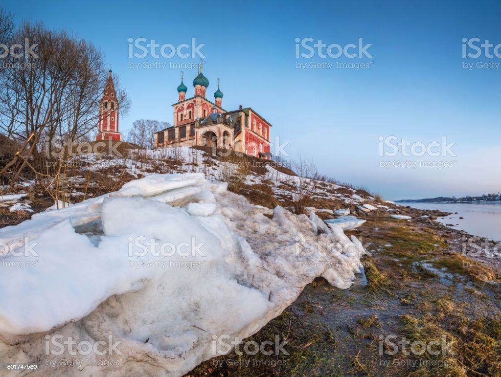 On the high bank of the Volga River there is a red church stock photo