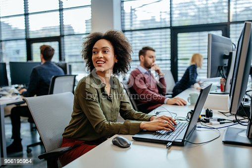 958531418 istock photo On the job with a smile 956195954
