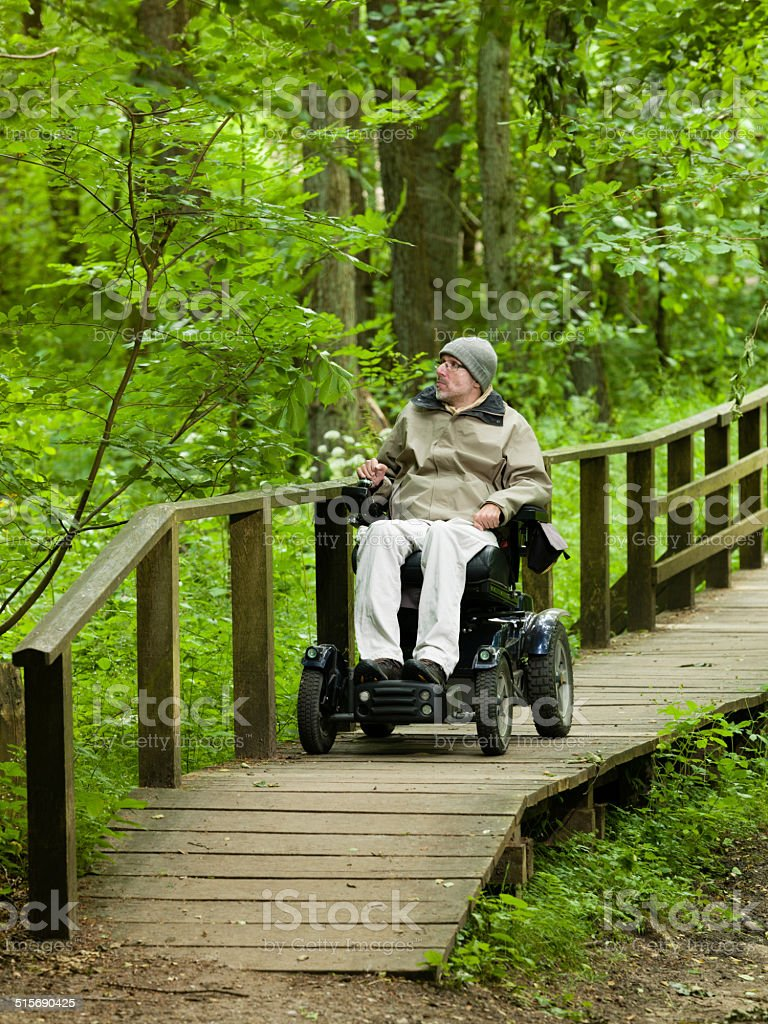 on the move, mobiliity with wheelchair stock photo