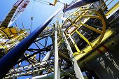 Looking up from the deck of an offshore drilling rig for oil and natural gas extraction.