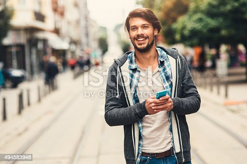 Portrait of a man with casual clothes in urban scene.