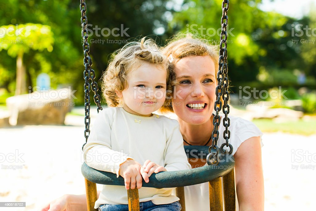 On the playground, baby swing stock photo